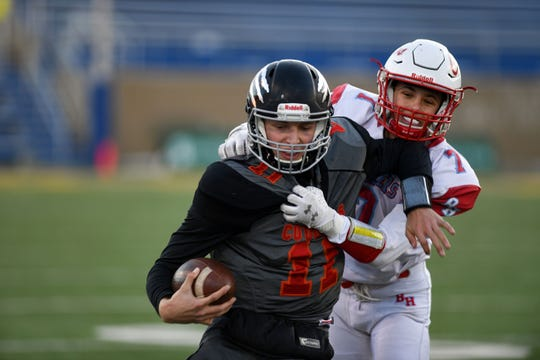 Isaac Crownover of Bon Homme attempts to tackle Chase Mason of Viborg-Hurley in the Class 9AA state football finals on Thursday, Nov. 14, at the Dana J. Dykehouse Stadium in Brookings.