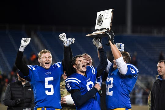 Canton football players celebrate winning the Class 11A state championship against Lennox on Thursday, Nov. 14, 2019, at Dana J. Dykhouse Stadium in Brookings, S.D. The final score of the game was 46-8.