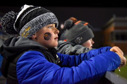 Gavin Groos, 7, watches Colman-Egan play Herreid/Selby Area in the Class 9B state championship on Thursday, Nov. 14, 2019, at Dana J. Dykhouse Stadium in Brookings, S.D.