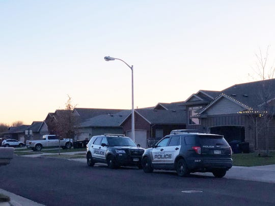 Sioux Falls Police patrol cars sit outside of a Sioux Falls home daycare on the 4700 block of South Wassom Avenue in southwestern Sioux Falls around 5:30 p.m. on Thursday.