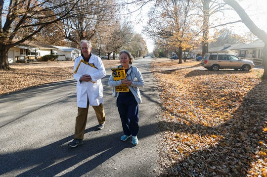 Dr. Doug McNeal and RN Susie Strozewski canvass a Springfield neighborhood campaigning to expand Medicaid in Missouri on Friday, Nov. 15, 2019.