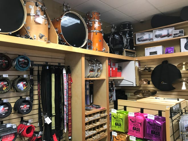 Drums and guitar accessories line the walls of Barrett's Music in St. Joseph on Wednesday, Nov. 13, 2019