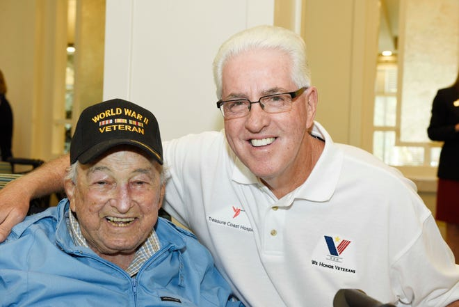 "Dan D. ""Gray"" Wolf, left, a World War II Army veteran, and Dennis Diamond at a 2019 Veterans Day ceremony at Watercrest Senior Living in St. Lucie West, facilitated by Treasure Coast Hospice. Diamond is a volunteer with Treasure Coast Hospice's We Honor Veterans program."