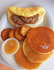 "Alice's Family Restaurant in Stuart offers a create-your-own light and fluffy omelet platter with a variety of fillings and accompaniments. This platter features an omelet with sauteed onions, mozzarella cheese and two sausage patties; mini potato pancakes with applesauce and ""baby"" pancakes."
