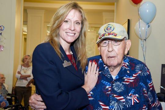 Bobi Kruemberg, left, executive director of Watercrest Senior Living, and World War II veteran Jack Rochester.