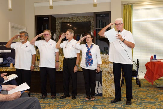 Treasure Coast Hospice Veteran Volunteers Frank Godinez, left, Frank Boyce, Michael Gangloff, Barbara Casuso and Dennis Diamond salute the veterans at Watercrest Senior Living in St. Lucie West.