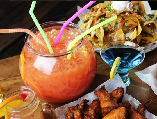 Signature cocktails at Bowlero include the 123-ounce Dunk Tank, served in a fishbowl with multiple straws for sharing.