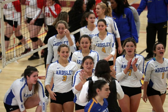 Ardsley players celebrate their 3-0 victory over Red Hook in the girls volleyball Class B regional semifinal action at Kingston High School Nov. 14, 2019.