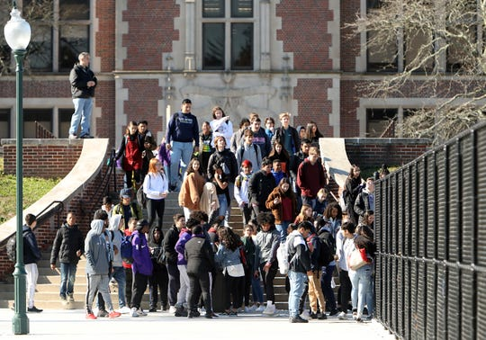 Students walk out to gather on the high school football practice field to show their support for reassigned football coach Lou DiRienzo Nov. 15, 2019 in New Rochelle.