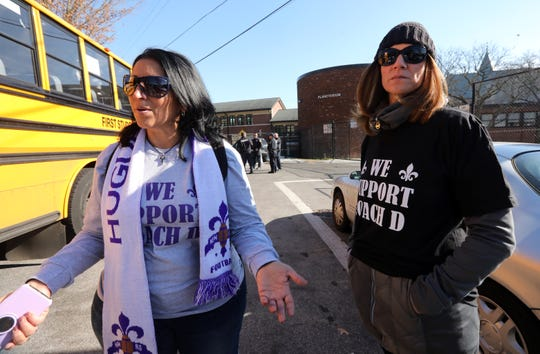 Football mom Gina Ruggiero and Jeni Temistokle show support for reassigned football coach Lou DiRienzo during a student walk out Nov. 15, 2019 in New Rochelle. Parents were not allowed on the field with the students and were unable to hand the students signs and t-shirts.