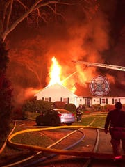 A fire burned through a house on Hunter Lane in Rye on Nov. 15, 2019.
