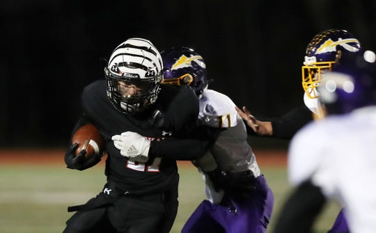 Tuckahoe's Michael Meyers (21) looks for some running room in the Waterville defense during the Class D state regional final at Mahopac High School Nov. 15, 2019.