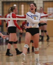 Ardsley's Rory McNerney (7) cheers a point against Red Hook's during the girls volleyball Class B regional semifinal action at Kingston High School Nov. 14, 2019. Ardsley won 3-0.