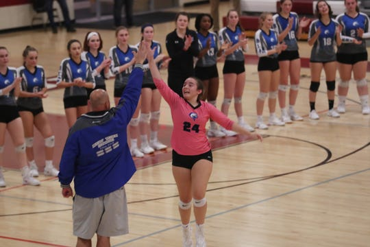 Millbrook's Bree McDermott gives a leaping high five to volleyball coach Shawn Stoliker during player introductions before the Class C regional semifinal on Nov. 14.