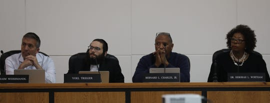 From left, School board members Raim Weissmandl, Yoel Triegel, Bernard Charles and Superintendent Deborah Wortham listen to a teacher during a Ramapo School board meeting in Spring Valley Oct. 28, 2019.