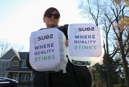 Kristy Engels from Piermont stands with protesters across from the Suez New York headquarters in West Nyack on Friday, November 15, 2019.