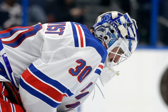 New York Rangers goaltender Henrik Lundqvist reacts after giving up a goal to the Tampa Bay Lightning during the second period of an NHL hockey game Thursday, Nov. 14, 2019, in Tampa, Fla.