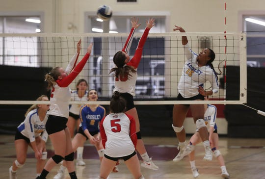 Ardsley's Kaija Watts (16) gets a shot over Red Hook's Lauren Totman (18) during the girls volleyball Class B regional semifinal action at Kingston High School Nov. 14, 2019. Ardsley won 3-0.