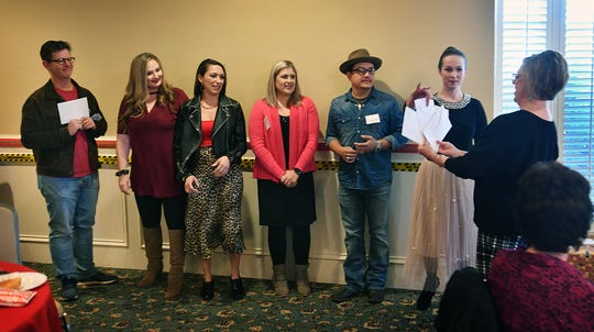 Vanda Cullar of the Small Business Development Center at Midwestern State University, right, allows celebrity dancers to draw for their instructors during the Dancing for the Stars Reveal luncheon Friday at The Forum. From left, Ward Roberts, Jessica Edwards, Michelle Cramer, Caroline Groves, James and Stacie Cook.
