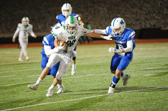 Windthorst's Gage Mcanally closes in on Shamrock rusher Hunter Stroope during the Trojans' 53-16 playoff victory on November 14, 2019.