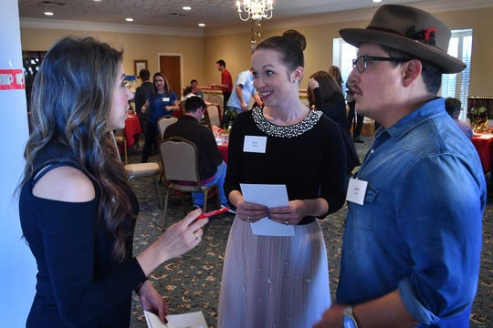 Dance instructor Alicia Ayers, left, talks with celebrity dancers Stacie and James Cook during Friday's Dancing for the Stars reveal luncheon at The Forum. The February 2020 event raises money for the Small Business Development Center at Midwestern State University and Big Brothers Big Sisters.