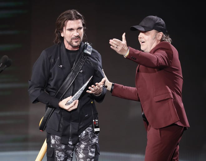 Metallica drummer Lars Ulrich presents Juanes with the 2019 Latin Recording Academy person of the year award.