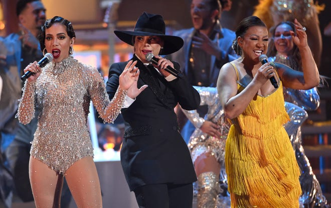 "Brazilian star Anitta, left, joins merengue legends Olga Tañon and Milly Quezada as they kick-start the 2019 Latin Grammys covering Celia Cruz's ""La Vida es un Carnaval."""