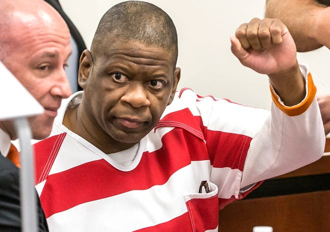 Death row inmate Rodney Reed, shown in a 2017 file photo, waves to his family in the Bastrop County District Court.