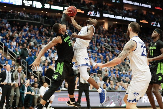 Michigan State forward Xavier Tillman blocks a shot by Seton Hall guard Quincy McKnight.