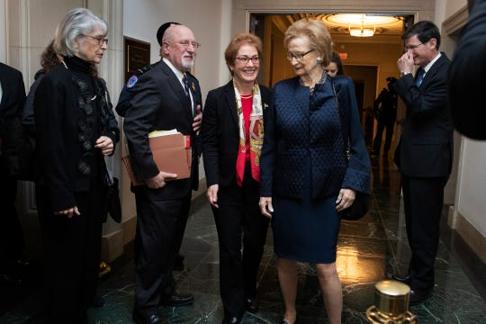 Former U.S. Ambassador to Ukraine Marie Yovanovitch, center, leaves the hearing room for a break during the second public impeachment hearing of President Donald Trump's efforts to tie U.S. aid for Ukraine to investigations of his political opponents on Nov. 15, 2019, on Capitol Hill in Washington.