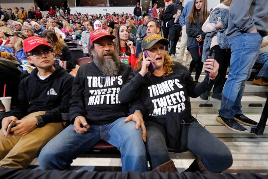 Pastor Sean Jones, center, of the New Beginnings Baptist Church in Walla Walla, Wash., waits for President Donald Trump to arrive at a campaign rally in Bossier City, La., Thursday, Nov. 14, 2019. (AP Photo/Gerald Herbert) ORG XMIT: LAGH201