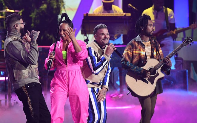 "Farruko, left, Alicia Keys, Pedro Capo and Miguel perform a feel-good performance of ""Calma""  during the 20th Annual Latin Grammy Awards."