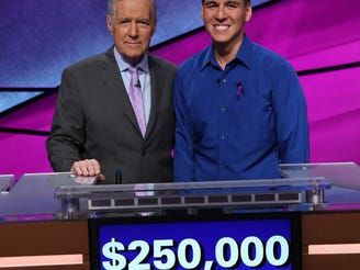 """James Holzhauer, with host Alex Trebek, won the 2019 """"Jeopardy!"""" Tournament of Champions, and added $250,000 to his winnings."""