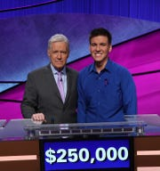 "James Holzhauer, with host Alex Trebek, won the 2019 ""Jeopardy!"" Tournament of Champions, and added $250,000 to his winnings."