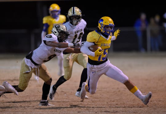 Wren's  Tyler Cherry rushes out of the tackle attempt by Greer's Ian Jackson Friday night at Wren.