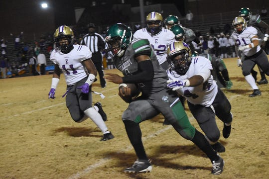 Peabody's Arthur Lavalais (1) rushes for a first down against Warren Easton Friday, Nov. 15, 2019 in a home playoff game.