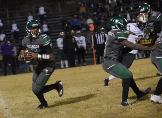 Peabody quarterback Tyriq Miles (5) tries to throw a pass against Warren Easton  Friday, Nov. 15, 2019 in a home playoff game. Warren Easton won 44-6.