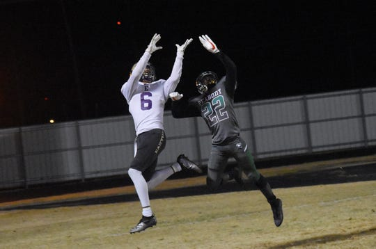 Peabody's Ja'darion Byrd (22) tracks a pass against Warren Easton Charter High School of New Orleans Friday, Nov. 15, 2019 in a home playoff game.