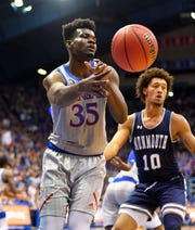 Kansas Jayhawks center Udoka Azubuike (35) passes the ball as Monmouth Hawks forward Jarvis Vaughan (10) defends during the first half at Allen Fieldhouse.