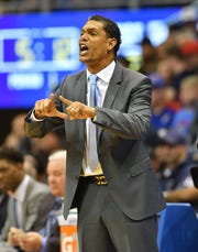 Monmouth Hawks head coach King Rice gestures from the sidelines during the first half against the Kansas Jayhawks at Allen Fieldhouse.
