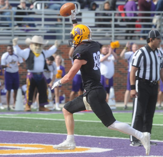 Hardin-Simmons receiver Jaxson Money holds the ball up after scoring a TD against Southwestern on Saturday, Nov. 16, 2019, at Shelton Stadium in Abilene.