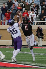 Nov 16, 2019; Lubbock, TX, USA; Texas Christian Horned Frogs quarterback Max Duggan (15) throws a pass against Texas Tech Red Raiders defensive linebacker Riko Jeffers (6) in the second half at Jones AT&T Stadium. Mandatory Credit: Michael C. Johnson-USA TODAY Sports