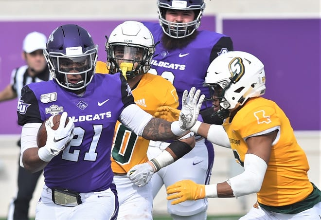 ACU running back Tracy James (21) fends off a Southeastern Louisiana defender during the first half of the Southland Conference game Nov. 16 at Wildcat Stadium.
