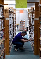 Don Powell sorts paperbacks at Book Therapy on Friday. The used bookstore also offers family and marriage counseling in the area where the science fiction books used to be.