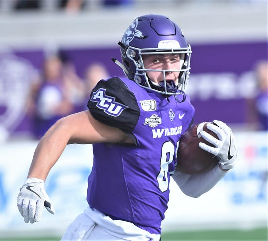ACU receiver Josh Fink looks back at the pursuing defense after catching a pass from Sema'J Davis. He was eventually tripped up for a 62-yard catch to the Southeastern Louisiana 6-yard line. Two plays later, Davis ran 2 yards for a TD to pull the Wildcats within seven (14-7) with 2:36 left in the first half of the Southland Conference game Saturday, Nov. 16, 2019, at Wildcat Stadium.