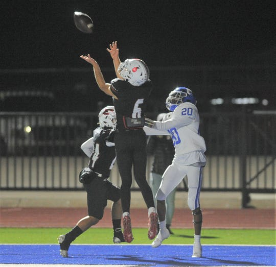 Ballinger defensive back Weston Rollwitz (6) breaks up a pass intended for Childress' Jamarcus Hampton (20) in the end zone in a Class 3A Division II bi-district playoff Friday, Nov. 15, 2019, at Newton Field in Graham.