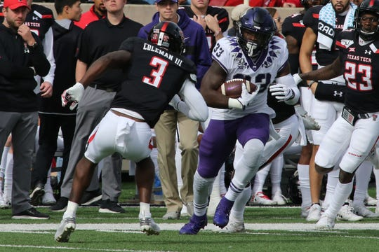 Nov 16, 2019; Lubbock, TX, USA; Texas Christian Horned Frogs running back Sewo Olonilua (33) runs the ball against Texas Tech Red Raiders safety Douglas Coleman (3) in the first half at Jones AT&T Stadium. Mandatory Credit: Michael C. Johnson-USA TODAY Sports