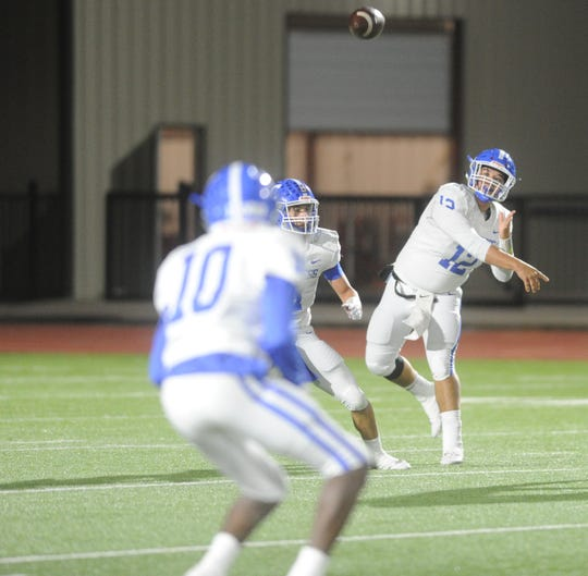 Childress quarterback Trent Mayden (12) throws a pass to Devron Sims against Ballinger in a Class 3A Division II bi-district playoff Friday, Nov. 15, 2019, at Newton Field in Graham.