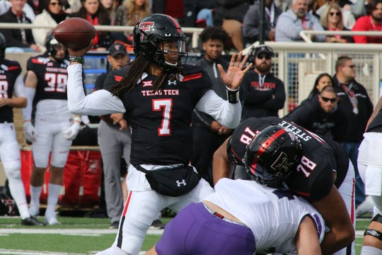 Nov 16, 2019; Lubbock, TX, USA; Texas Tech Red Raiders quarterback Jett Duffey (7) passes the ball against the Texas Christian Horned Frogs in the first half at Jones AT&T Stadium. Mandatory Credit: Michael C. Johnson-USA TODAY Sports