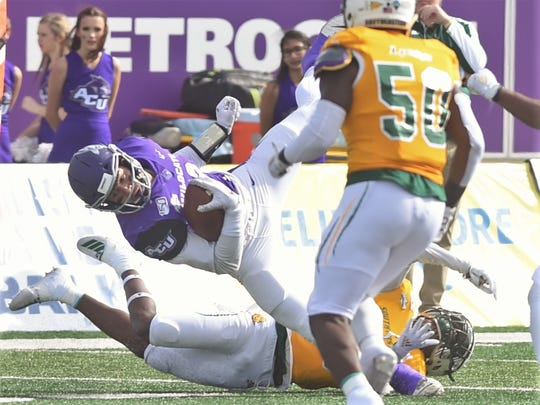 ACU receiver Branden Hohenstein is upended by a Southeastern Louisiana defender after making a catch in the first quarter of the Southland Conference game Saturday, Nov. 16, 2019, at Wildcat Stadium.